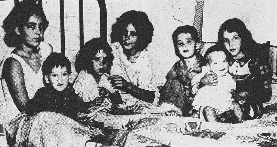 "If you think you have trouble, then have a look at Mrs. J.W. Merritt's plight. Her eight children (from left) — Edna, 11, Robbie, 2, Elaine, 5, Glenda, 10, Sammy, 4, Melba, 6, and Kay, 1 — have or have had the measles over the past three weeks.  Melba has failed to come down with the disease, and eldest son Coy, 8 (not pictured), has recuperated and returned to classes at Castle Hills Elementary School. Meanwhile, Mr. Merritt has been out of town during the siege, hauling heavy equipment for the J.E. Ingram Equipment Co. ""He doesn't know what he's missing,"" Mrs. Merritt said. Published in the San Antonio Light May 18, 1953. Photo: File Photo"