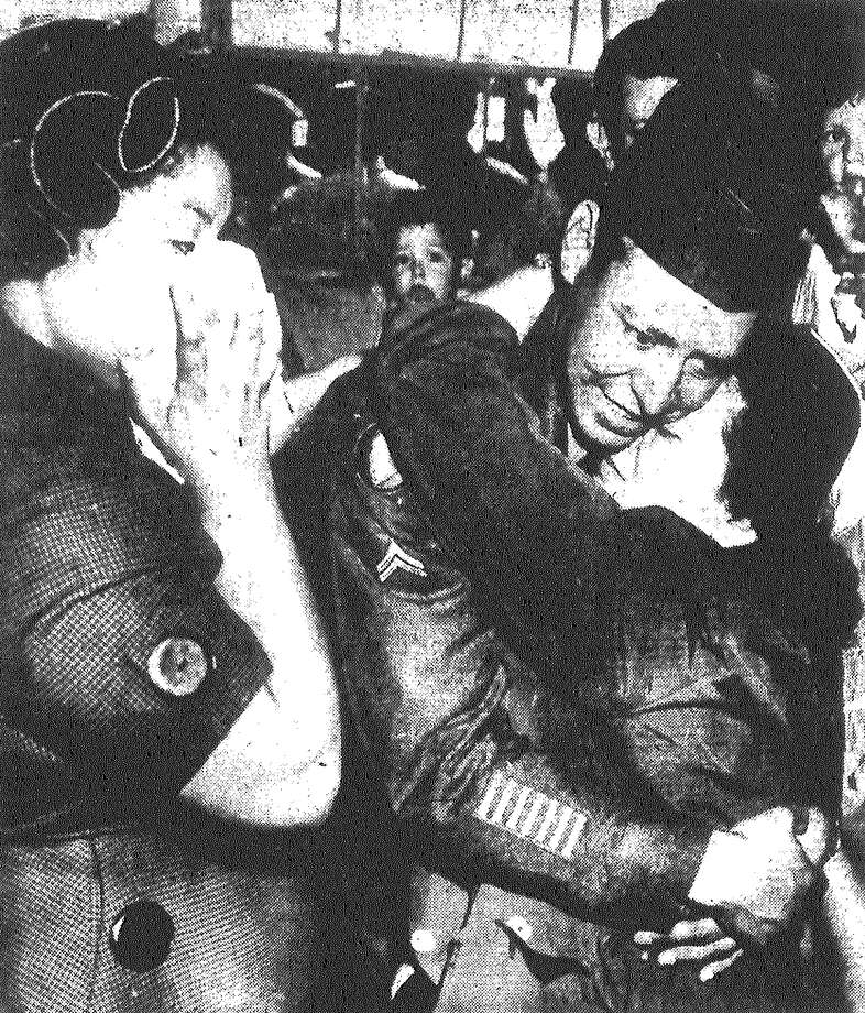 Cpl. John King embraces sister Mrs. Matthew J. Blaszcyk as another sister Mrs. Guido G. Raso weeps during their reunion. King's San Antonio stopover was brief. After the reunion, he boarded an Air Force C-47 for transfer to a hospital at Orlando, Fla., for further treatment. Published in the San Antonio Light May 8, 1953. Photo: File Photo