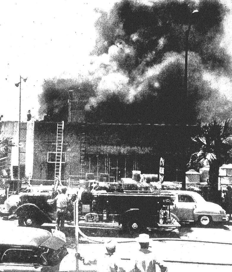 Thick clouds of smoke pour from Kallison's store in the 100 block of S. Flores Street. City firemen were praised by Perry and Morris Kallison for their speed in putting out the fire, which did an estimated $100,000 damage to their department store. Published in the San Antonio Light May 28, 1953. Photo: File Photo