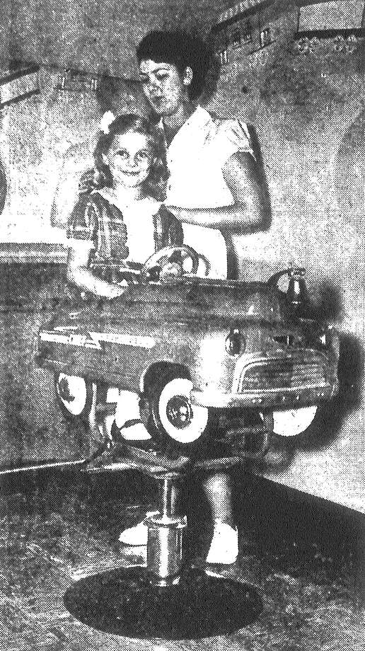 Little Aubrey Jean Kline sits in a red fire engine, ready for a haircut at Joske's beauty salon for youngsters. Published in the San Antonio Light May 26, 1953. Photo: File Photo