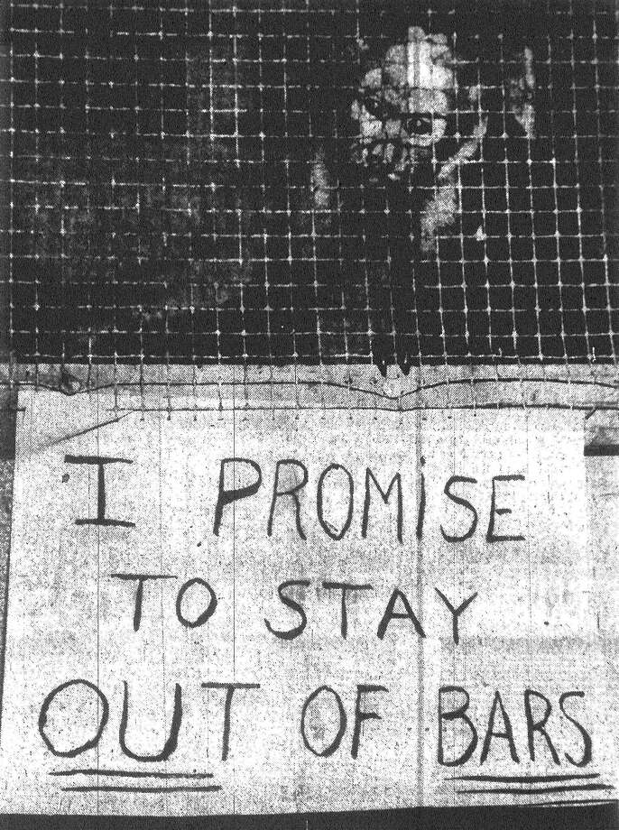 """""""Honest, a short one was all I meant to have,"""" moans Jodie, an alcohol-loving, 20-month-old monkey who sneaked into the Broadway Bar, 310 N. Alamo St., and wreaked $125 worth of havoc before police stopped him. He's sorry now and back in his next door cage. Published in the San Antonio Express May 24, 1953. Photo: File Photo"""
