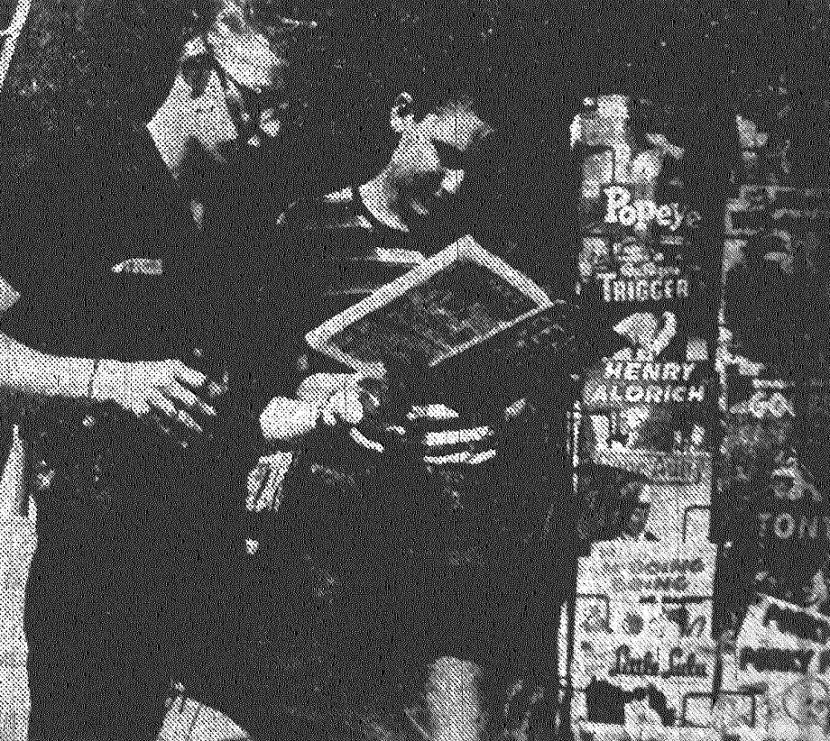 Jerry Kelley and Jerry Mitchell, both 14, stop at an ice house for a cold drink and to leaf through a large selection of comic books. Published in the San Antonio Express May 22, 1953. Photo: File Photo