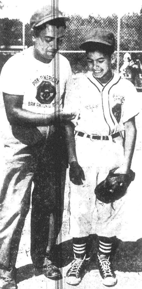 Manager Adam Vasquez of Little League Club No. 2 in the Pan-American Optimist League talks with pitcher Mario Arellano. Published in the San Antonio Express May 31, 1953. Photo: File Photo