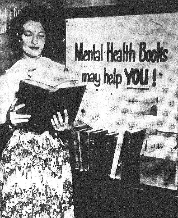 Miss Edna Naegelin looks over mental health books which are on display in the main reading room of the public library. The display is in connection with the fundraising efforts of the Guidance Institute and the Bexar County Society for Mental Hygiene. Published in the San Antonio Light May 29, 1953. Photo: File Photo