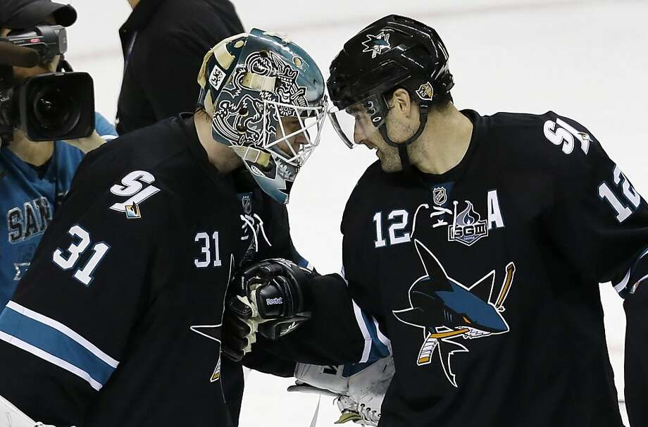 San Jose Sharks' Antti Niemi, of Finland, left, celebrates with teammate Patrick Marleau after a 5-2 win over the Vancouver Canucks during Game 3 of their first-round NHL hockey Stanley Cup playoff series in San Jose, Calif., Sunday, May 5, 2013. (AP Photo/Marcio Jose Sanchez) Photo: Marcio Jose Sanchez, Associated Press