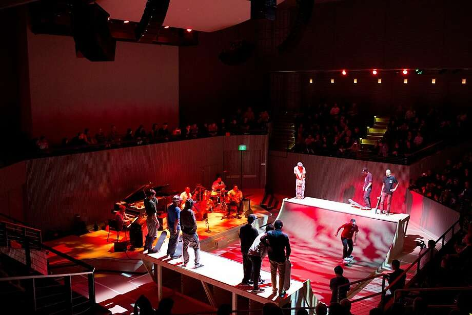 Skaters skate a mini ramp while jazz musician Jason Moran and his band perform at the SF Jazz Center in San Francisco, Calif., Sunday, May 5, 2013. The center built a ramp on the dance floor of their new facility and about 10 skaters put on a show for a sold out crowd while Moran and his band played music based off of the skating. Photo: Jason Henry, Special To The Chronicle