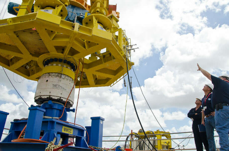 MWCC Operations Superintendent Chip Ledbetter provided BSEE Director James Watson and BSEE Lead Inspector Kelly Bouzigard with an overview of the capping stack during pre-deployment testing at Greensport in Houston. Photo: Marine Well Containment Company
