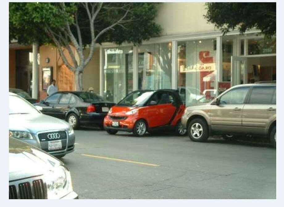 Ah, the Smart Car being used to do something dumb. Photo via reader Jim C. of the street in front of a Marina Dist. Starbucks