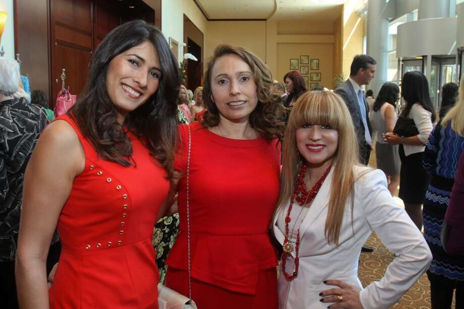 Marianelly Noble, from left, Lillie Havlik and Iraima Franco at the Latin Women's Initiative luncheon and fashion show.