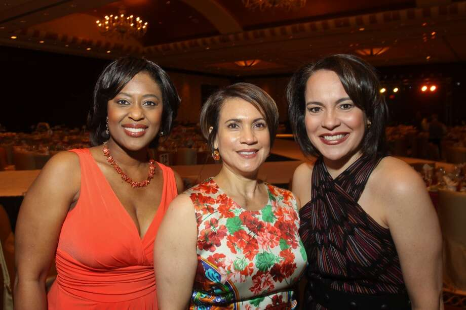 Sharron Melton, from left, Marlyn Greiner and Rosi Hernandez at the Latin Women's Initiative luncheon and fashion show.