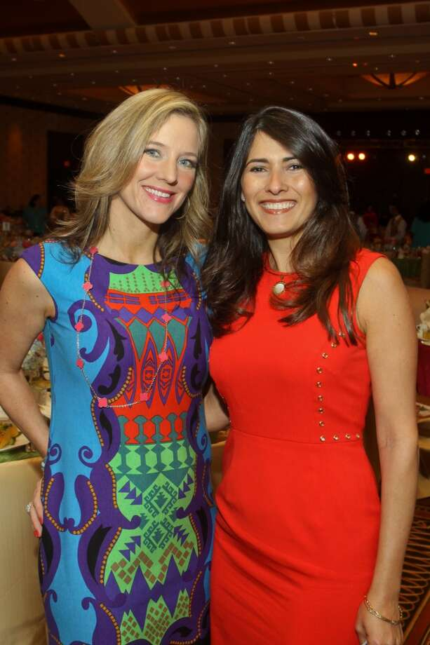 Sally Lechin, left, and Marianelly Noble at the Latin Women's Initiative luncheon and fashion show.
