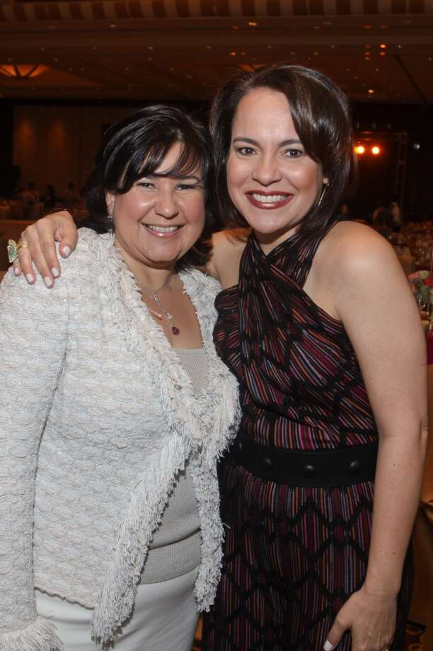 Lisset Garza, left, and Rosi Hernandez at the Latin Women's Initiative luncheon and fashion show.