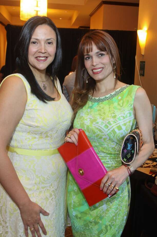 Maria Salas, left, and Karina Barbieri at the Latin Women's Initiative luncheon and fashion show.