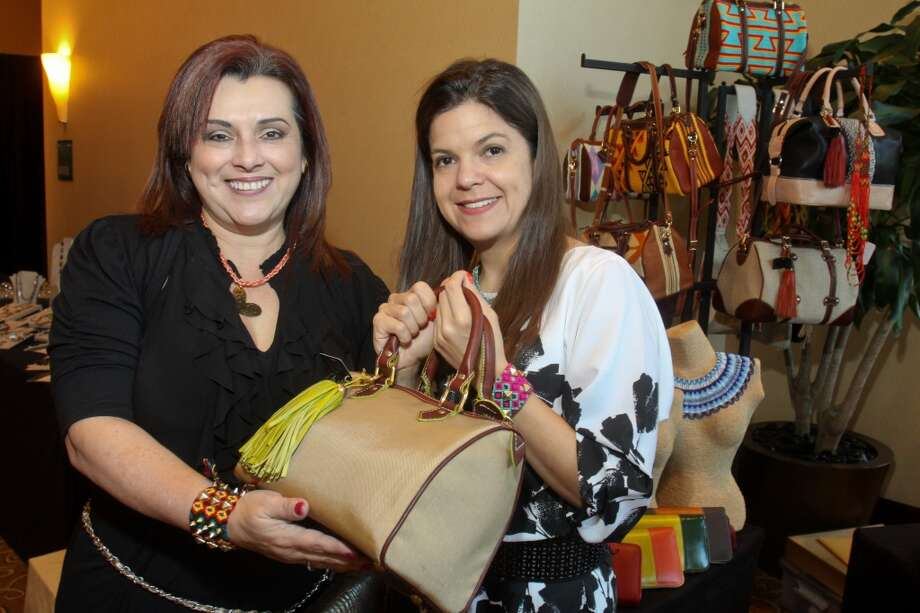 "Soledad Tomayo, left, and designer Claudia Gutierrez with one of her ""Claudia G."" designs at the Latin Women's Initiative luncheon and fashion show."