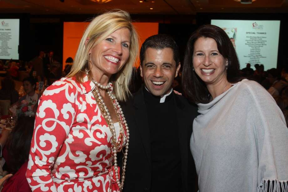 Penny Grams, from left, Father T.J. Martinez and Joy Posoli at the Latin Women's Initiative luncheon and fashion show.