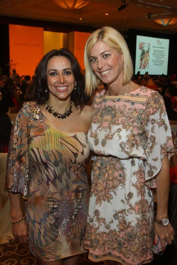 Monica Crawford, left, and Janine Jones at the Latin Women's Initiative luncheon and fashion show.