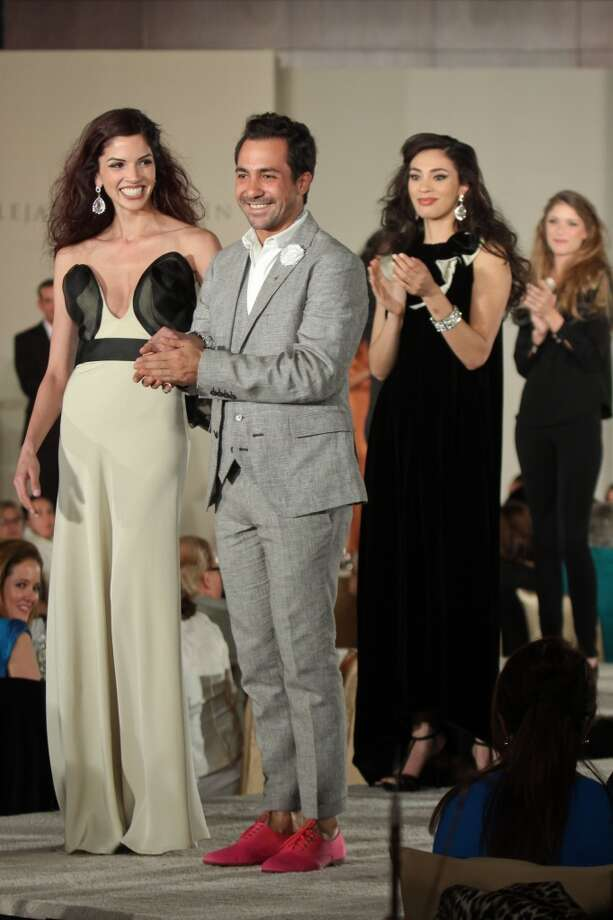 Alejandro Carlin with models after the show featuring his fashions at the Latin Women's Initiative luncheon and fashion show.