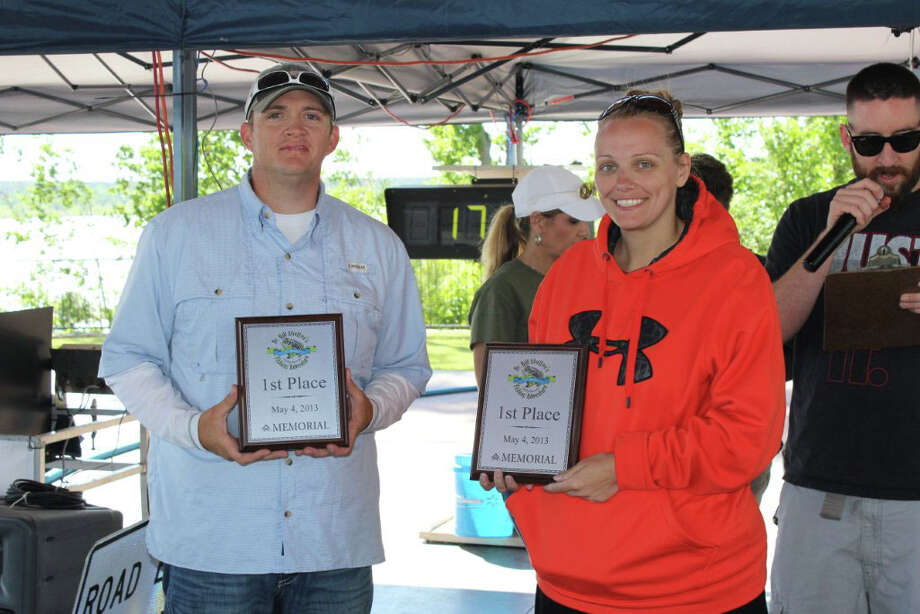 Ben and Addie Craven with their first place trophies after weighing in 23.95 lbs. Photo by Paul Hayes