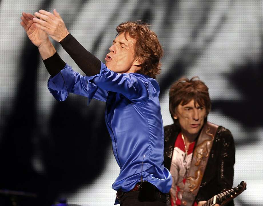 Mick Jagger and Ron Wood of the Rolling Stones perform on stage on Sunday. The Rolling Stones played the Oracle Arena in Oakland, Calif., on Sunday, May 5, 2013, as part of their 50th anniversary tour. Photo: Carlos Avila Gonzalez, The Chronicle