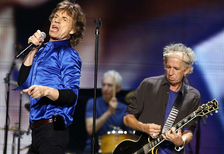 Mick Jagger, left, Keith Richards, right, and Charlie  Watts, center, of the Rolling Stones perform on Sunday. The Rolling Stones played the Oracle Arena in Oakland, Calif., on Sunday, May 5, 2013, as part of their 50th anniversary tour. Photo: Carlos Avila Gonzalez, The Chronicle