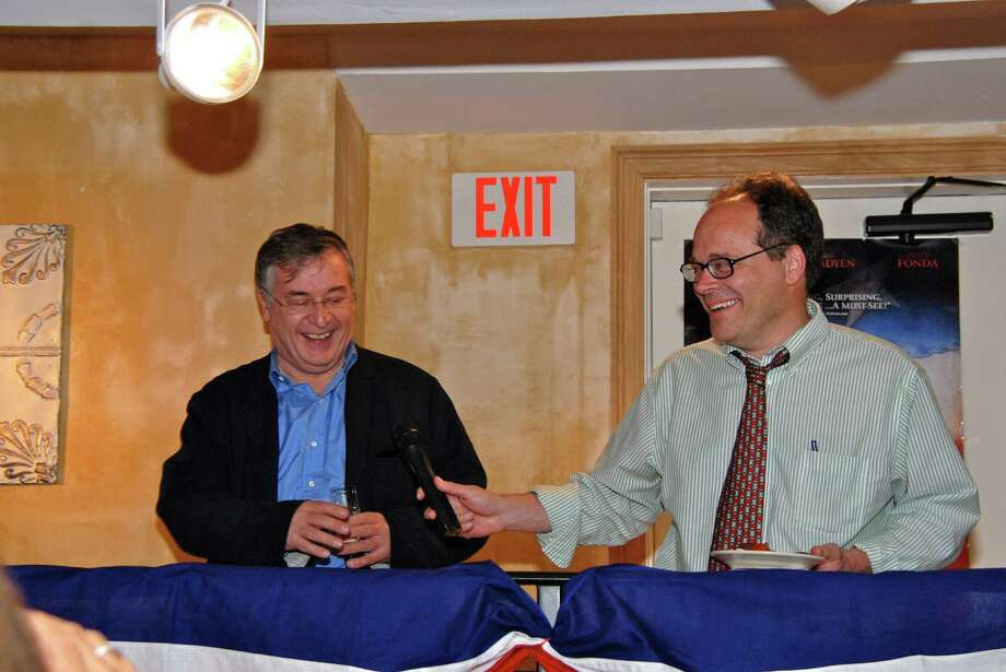 "Screenwriter Bill Kauffman hands off the microphone to director Ron Maxwell during the Q & A portion of the reception for their new movie ""Copperhead."" The reception at Le Pain Quotidien, followed the movie's advance screening shown earlier in the evening. May 1, 2013, New Canaan, Conn. Photo: Jeanna Petersen Shepard / New Canaan News Freelance"