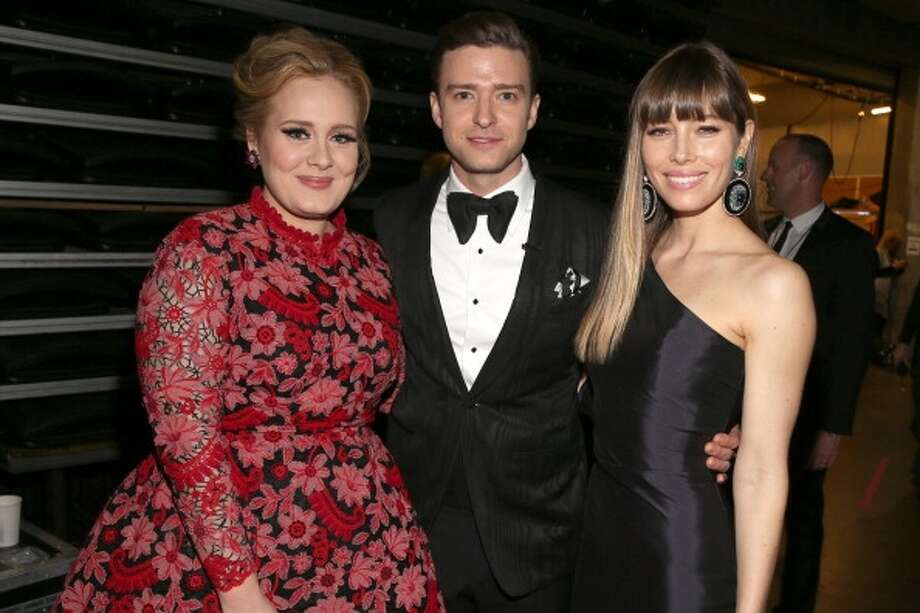 At the 2013 Grammy awards with wife Jessica Biel and Adele. (Christopher Polk/Getty)