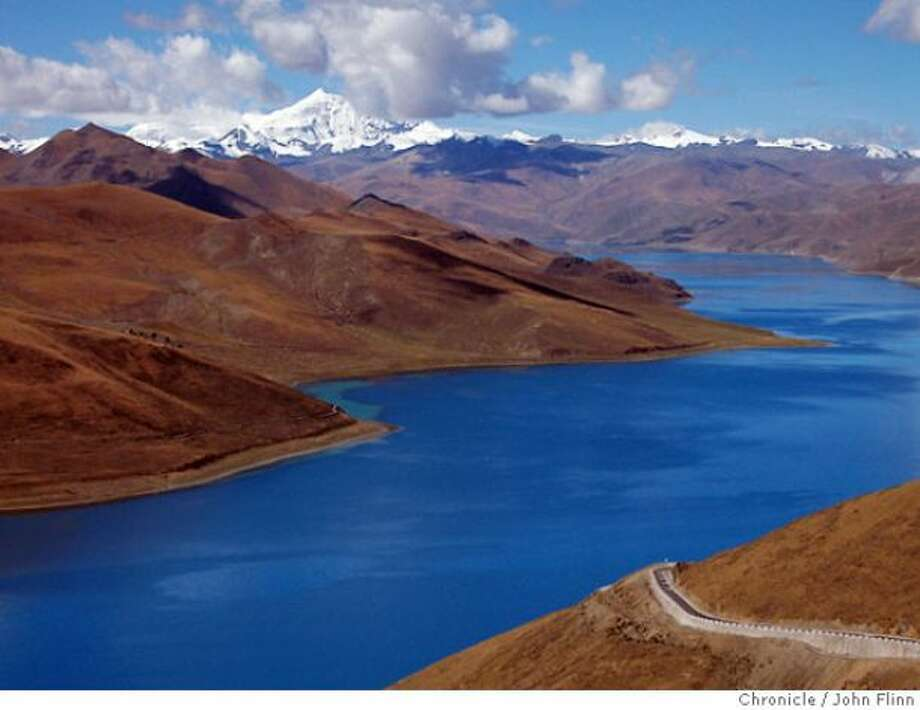 "Nam-Tso lake in Tibet. The road is part of the ""Friendship Highway"" to Nepal."