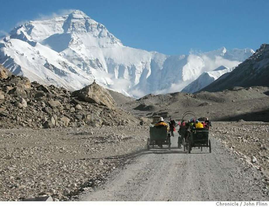 Pony carts take visitors from the Rongbuk Monastery to Everest Base Camp in Tibet. That's the north face of Everest in the background.