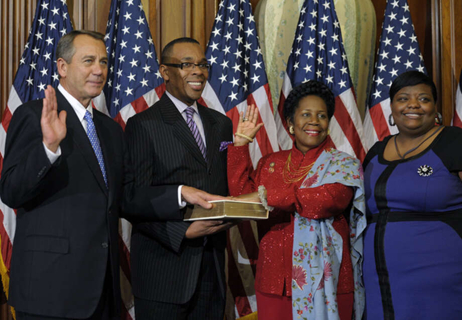 House Speaker John Boehner, of Ohio performs a mock swearing in for Rep. Sheila Jackson Lee, D-Texas, Thursday, Jan. 3, 2013, on Capitol Hill in Washington as the 113th Congress began. (AP Photo/Cliff Owen) Photo: Cliff Owen, Associated Press / FR170079 AP
