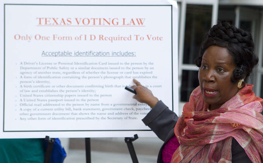 VOTING: Rep. Sheila Jackson Lee speaks holds a news conference in front of the federal courthouse on Monday, Nov. 5, 2012, to inform Houston-area voters about the process in Harris County and the state of Texas. Photo: Cody Duty, Houston Chronicle / © 2012 Houston Chronicle