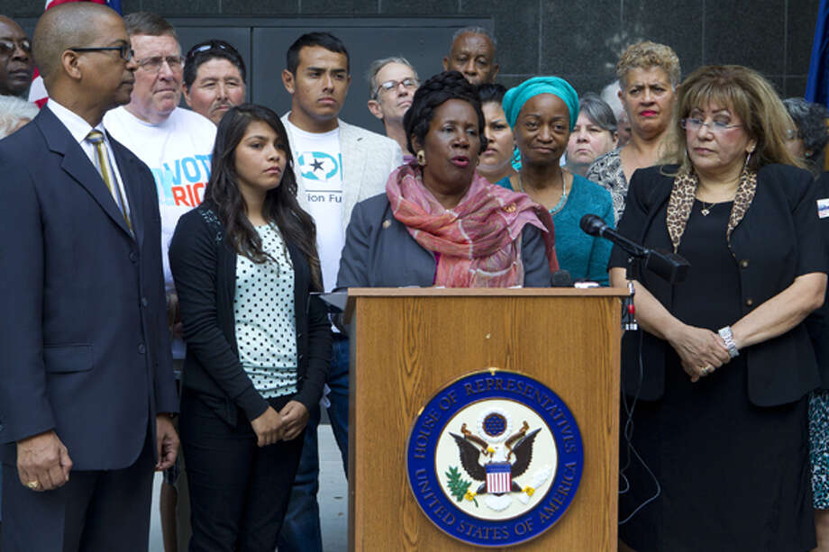 Congresswoman Sheila Jackson Lee speaks as she stands with officials and voters of the community during a press conference in front of the Federal Courthouse Monday, Nov. 5, 2012, in Houston. Lee held the press conference to inform the public about the voting process in Harris County and the state of Texas, such as where to vote and who to call to get additional information. (Cody Duty / Houston Chronicle) Photo: Cody Duty, Houston Chronicle / © 2012 Houston Chronicle