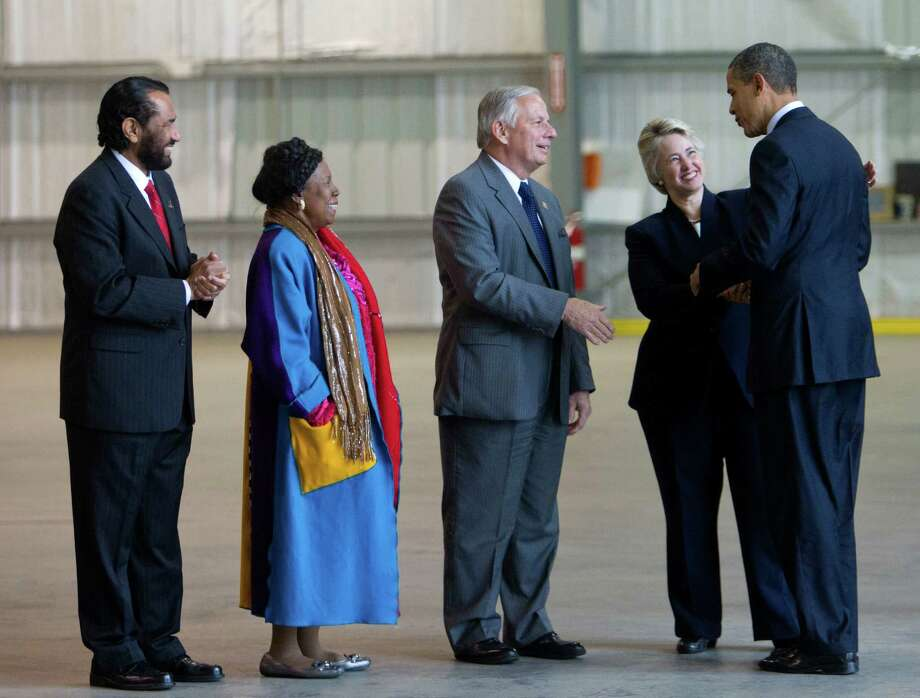 President Barack Obama is welcomed by Houston Mayor Anisse Parker, Congressman Gene Green, Congresswoman Shelia Jackson Lee and Congressman Al Green on March 9, 2012, in Houston. Photo: Bob Levey, The Associated Press / AP