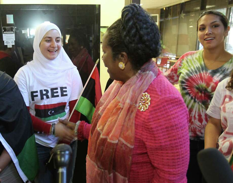 LIBYA: Sara Baaba of Houston shakes hands after Rep. Sheila Jackson Lee made a statement about Moammar Gadhafi's death and what she hopes to see in the North African country's future on Thursday, Oct. 20, 2011, in the Mickey Leland Federal Building in Houston. Photo: Nick De La Torre, Houston Chronicle / © 2011  Houston Chronicle
