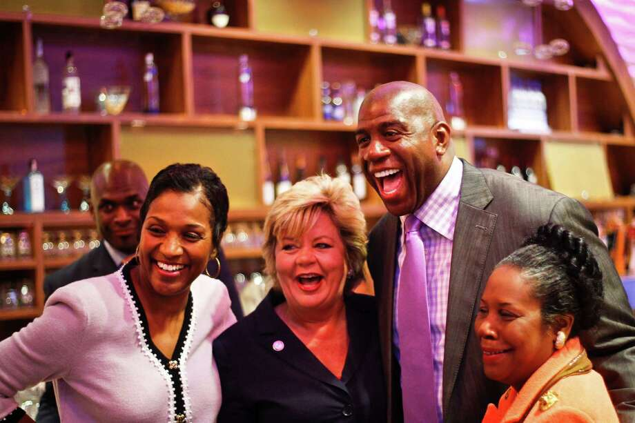 """Earvin """"Magic"""" Johnson stands between City Council Member Brenda Stardig and Rep. Sheila Jackson Lee as Hazel Ramsey, Society Editor for Houston Forward Times, looks on during a media tour of the newly renovated Marq*E Entertainment Center, Tuesday, Oct. 18, 2011, in Houston. Photo: Michael Paulsen, Houston Chronicle / © 2011 Houston Chronicle"""