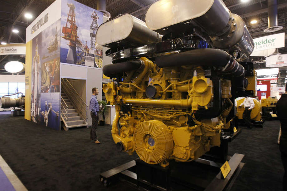 Jason Herlehy looks at a piece of equipment at the Offshore Technology Conference. Photo: Cody Duty, Houston Chronicle