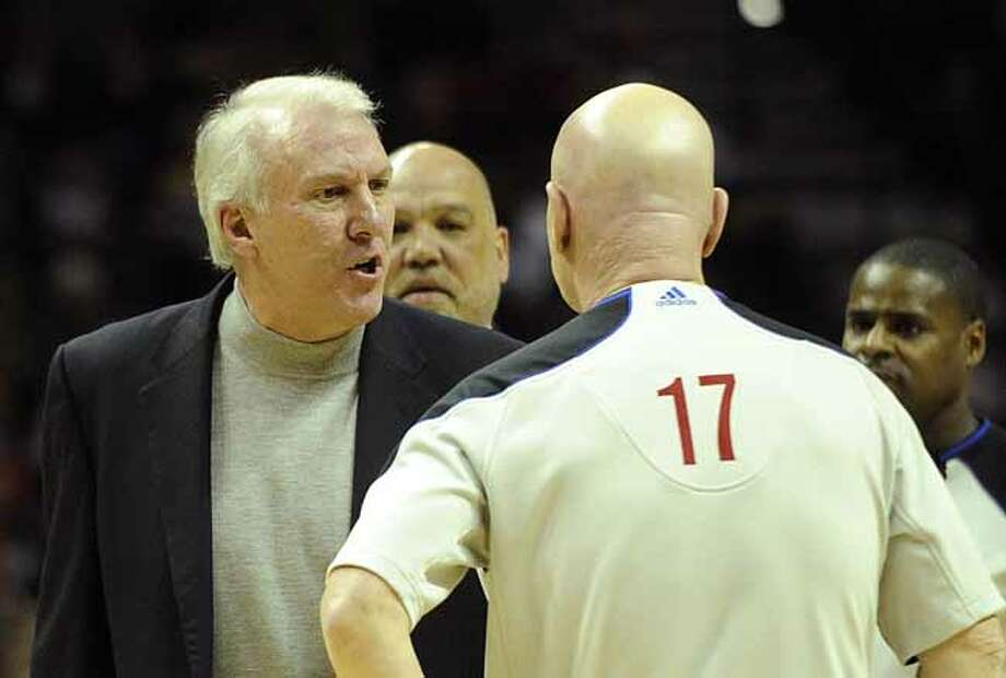Spurs head coach Gregg Popovich yells at official Joe Crawford moments before he leaves the AT&T Center court upon being ejected early in the second quarter during NBA action against Dallas on Friday, Jan. 8, 2010. BILLY CALZADA / gcalzada@express-news.netDallas Mavericks vs. San Antonio Spurs Photo: Billy Calzada, San Antonio Express-News / gcalzada@express-news.net