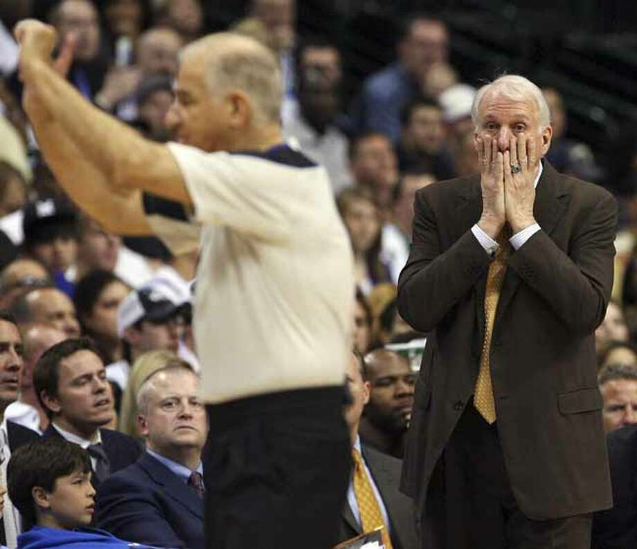 FOR  SPORTS - Spurs' headcoach Gregg Popovich reacts after a foul was called on Spurs' Keith Bogans during second half action  of Game 1 of the first round of the Western Conference playoffs against the Mavericks Sunday April 18, 2010 at the American Airlines Center in Dallas, Tx. The Mavericks won 100-94. (PHOTO BY EDWARD A. ORNELAS/eaornelas@express-news.net) Photo: Edward A. Ornelas, San Antonio Express-News / © 2010 SAN ANTONIO EXPRESS-NEWS