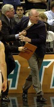 Spurs head coach Gregg Popovich is restrianed by assistant coach Hank Egan after Popovich protetsed a flagrant foul call on Danny Ferry at the Alamodome on Monday, May 7, 2001. Popovich received a douvle technical and was ejected in the 2nd quarter.   Kin Man Hui/staff. Photo: Kin Man Hui, San Antonio Express-News / San Antonio Express-News