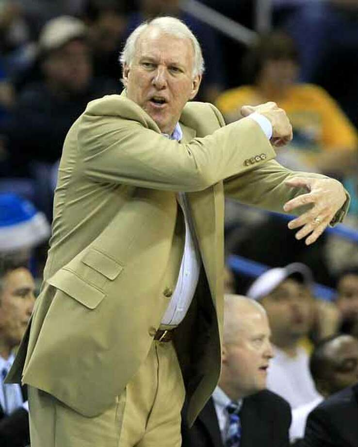 San Antonio Spurs head coach Gregg Popovich gestures to his players in the second half of an NBA basketball game against the New Orleans Hornets in New Orleans, Sunday, Nov. 28, 2010. San Antonio defeated New Orleans 109-95. (AP Photo/Patrick Semansky) Photo: Patrick Semansky, Associated Press / AP