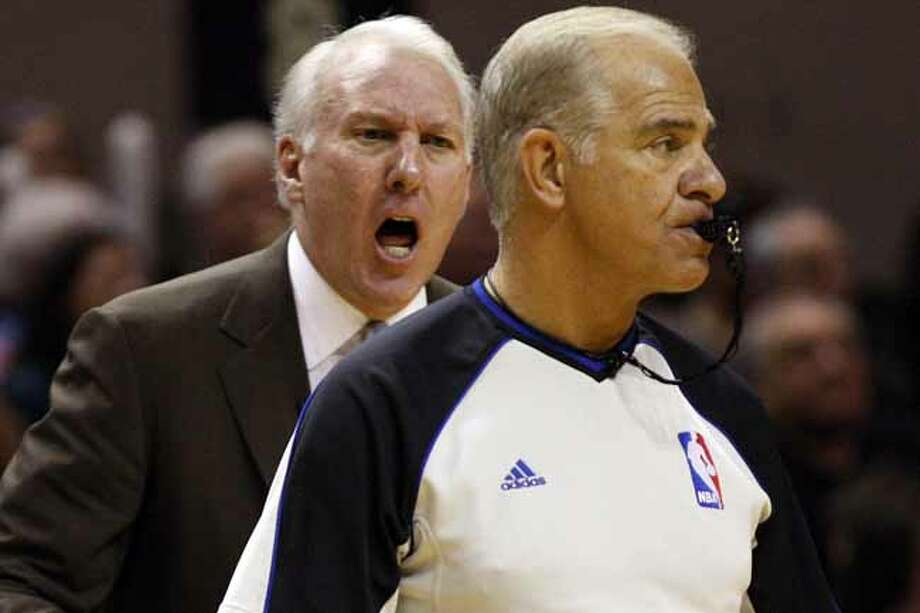 SPURS -- San Antonio Spurs Head Coach Gregg Popovich prostest a call by Bennett Salvatore during their game against the Los Angeles Lakers, at the AT&T Center, Sunday, March 6, 2011. JERRY LARA/glara@express-news.net Photo: Jerry Lara, San Antonio Express-News / SAN ANTONIO EXPRESS-NEWS (NFS)