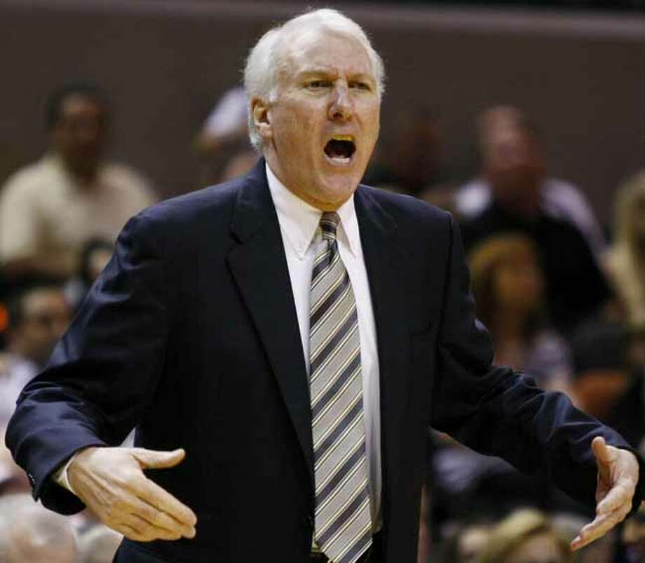 San Antonio Spurs head coach Gregg Popovich yells during the first half of an NBA basketball game against the Charlotte Bobcats, Saturday, March 19, 2011, in San Antonio. (AP Photo/Darren Abate) Photo: Darren Abate, Associated Press / FR115 AP