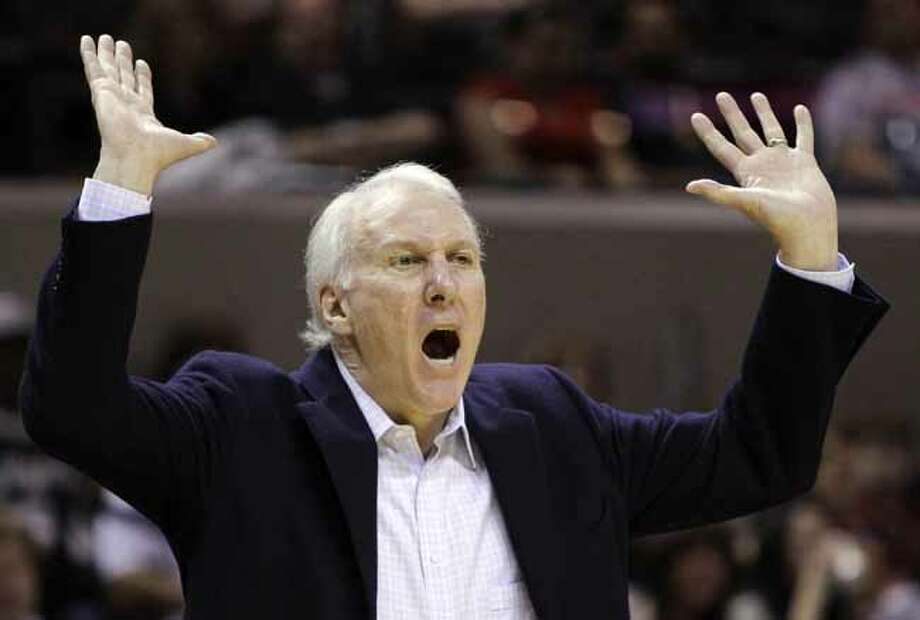 San Antonio Spurs coach Gregg Popovich reacts during the first quarter of an NBA basketball game against the Utah Jazz, Saturday, April 9, 2011, in San Antonio. (AP Photo/Eric Gay) Photo: Eric Gay, Associated Press / AP