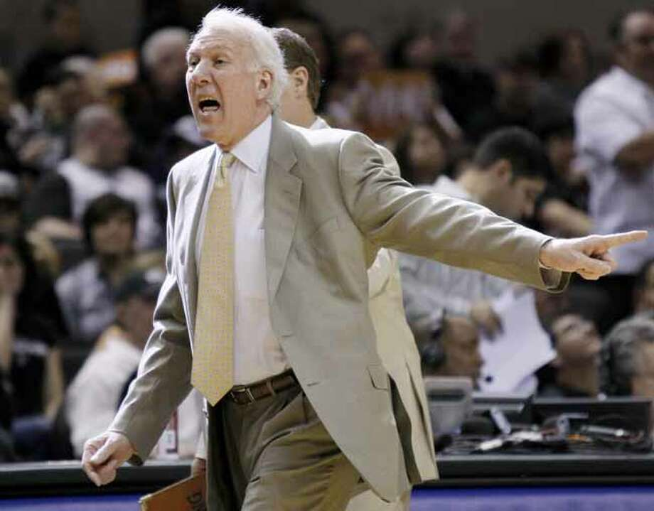 San Antonio Spurs head coach Gregg Popovich yells during the first half of an NBA playoff basketball game against the Memphis Grizzlies, Sunday, April 17, 2011, in San Antonio. (AP Photo/Darren Abate) Photo: Darren Abate, Associated Press / FR115 AP