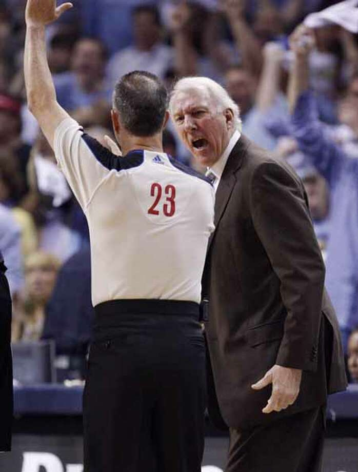 SPURS -- San Antonio Spurs Head Coach Gregg Popovich yells to official Jason Phillips for a timeout against the Memphis Grizzlies during first half of game six of the Western Conference First Round at FedExForum, Friday, April 29, 2011. JERRY LARA/glara@express-news.net Photo: Jerry Lara, San Antonio Express-News / SAN ANTONIO EXPRESS-NEWS (NFS)