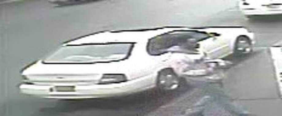 Albany police said a man who robbed the 99 Plus Discount Store at 632 Central Ave., Albany on April 10 fled in this vehicle, a white Nissan Altima. (Albany Police Department)