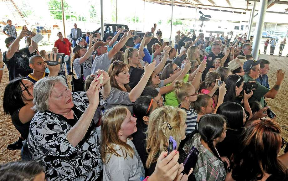 Kree Harrison fans gather at the Tyler County Rodeo Arena outside of Woodville on Saturday, May 4, 2013, to see Harrison perform a song.  Before the short concert locals participated in mutton busting and a dance contest. Photo taken: Randy Edwards/The Enterprise