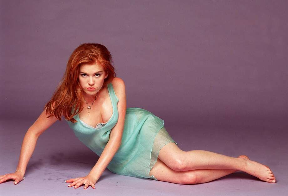 Not sure what this pose was supposed to convey, but it's Isla Fisher in 1998.