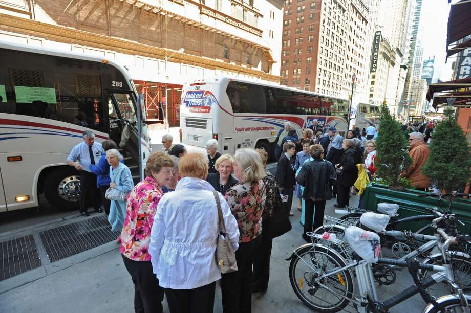 Fans from the capital district get off buses in NEW YORK to witness the Albany Symphony Orchestra's debut concert at Carnegie Hall Tuesday May 10, 2011. (Lori Van Buren / Times Union) Photo: Albany Times Union