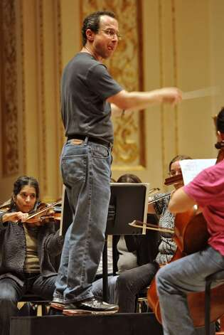 David Alan Miller conducts the Albany Symphony Orchestra during rehearsal before it's debut concert at Carnegie Hall in NEW YORK Tuesday May 10, 2011. (Lori Van Buren / Times Union)