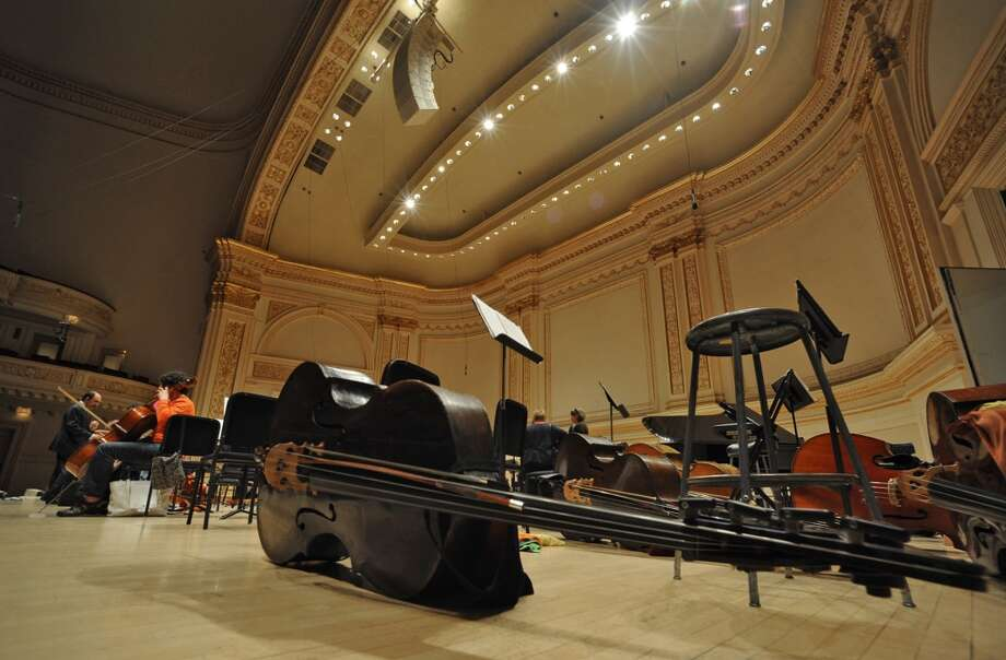 Matt Capobianco of Worcester, MA continues to play his cello shortly after the  Albany Symphony Orchestra finished rehearsal before it's debut concert at Carnegie Hall in NEW YORK Tuesday May 10, 2011. (Lori Van Buren / Times Union) Photo: Albany Times Union